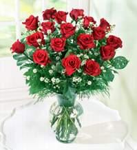 Bursa çiçek yolla  9 adet mika yada vazoda kirmizi güller