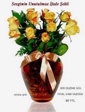 Bursa çiçek yolla  mika yada Cam vazoda 12 adet sari gül